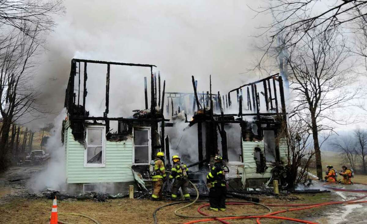 Despite efforts by several fire companies, a fire consumed 33 Matala Lane in Pittstown, N.Y., on Tuesday, April 5, 2011. (Skip Dickstein / Times Union)