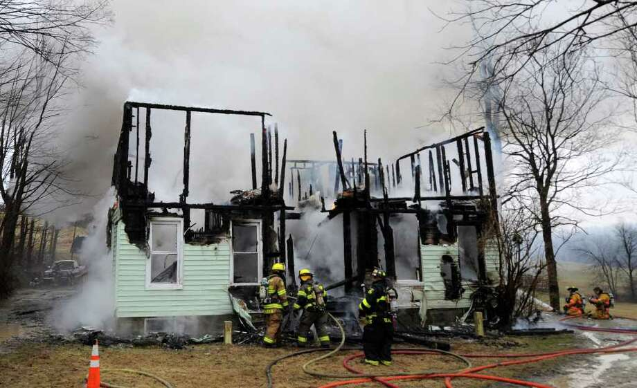 Despite efforts by several fire companies, a fire consumed 33 Matala Lane in Pittstown, N.Y., on Tuesday, April 5, 2011.    (Skip Dickstein / Times Union) Photo: SKIP DICKSTEIN