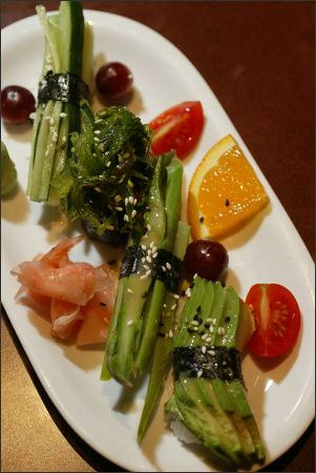 Bonzai Pub and Bistro offers a Veggie Nigiri sushi plate for $4 during happy hour. The dish includes seaweed, asparagus, avocado and cucumber. Photo: Karen Ducey, Seattle Post-Intelligencer / Seattle Post-Intelligencer
