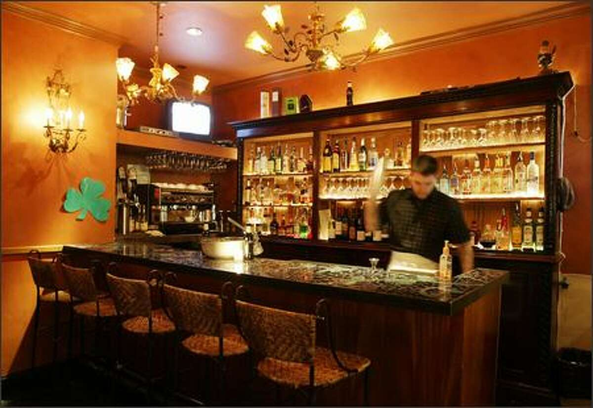 The compact bar has stools and booths for friends to gather, and offers nearly two dozen wines by the glass.