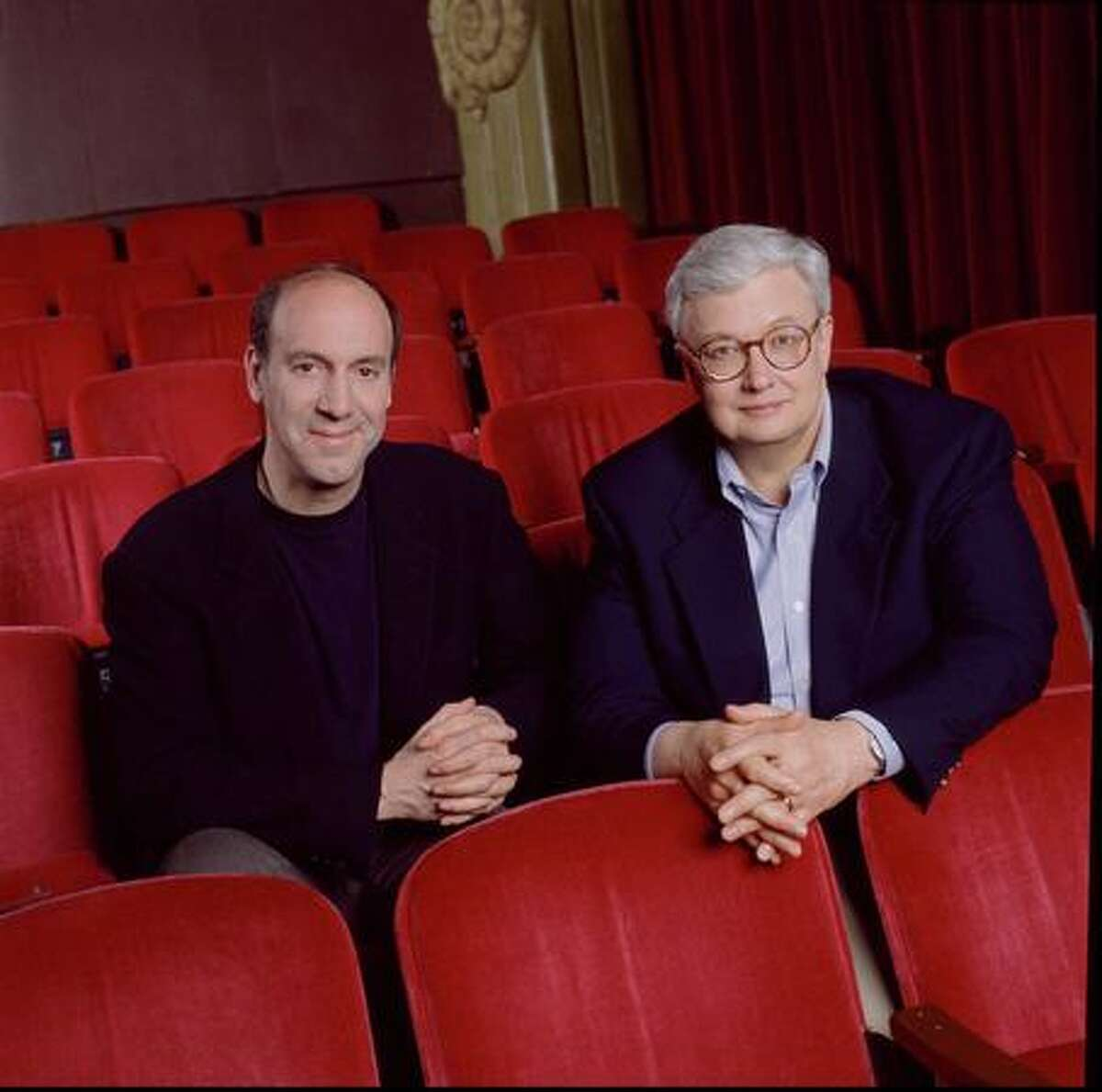 Film critics Roger Ebert (right) and the late Gene Siskel in a promotional photo for one of their TV shows taken in 1996.