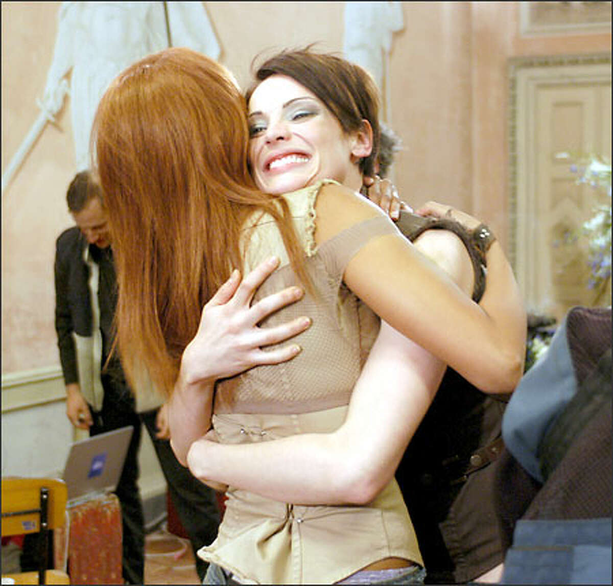 Host Tyra Banks gives Yoanna a congratulatory hug.