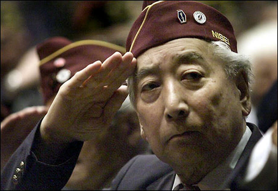 "WWII Veteran Frank T. Matsuda of Company ""H"" salutes with fellow Washington Nisei who served as the Honor Guard for a Medal of Honor ceremony for Pfc. William K. Nakamura and Technician Fifth Grade James K. Okubo at the Mercer Center. Photo: Paul Kitagaki Jr., Seattle Post-Intelligencer / Seattle Post-Intelligencer"