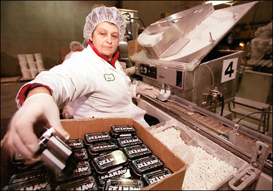 Lyubov Nikityuk packages freshly made Myntz! candies at the Vitech America plant in Kent. The mint has sold well in a competitive Seattle market. Photo: Phil H. Webber, Seattle Post-Intelligencer / Seattle Post-Intelligencer