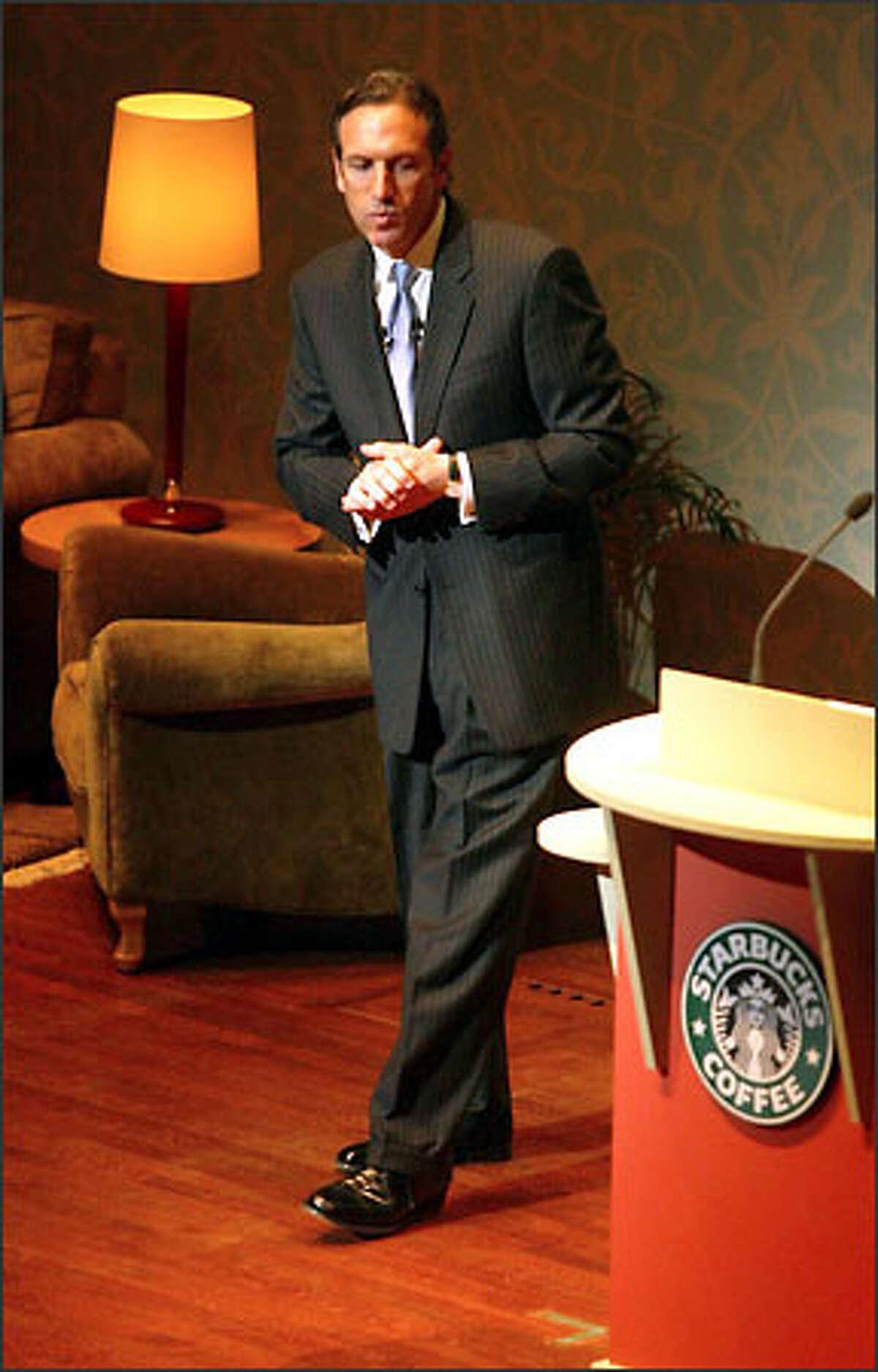 Starbucks Chairman Howard Schultz addresses shareholders at yesterday's annual meeting at Benaroya Hall.