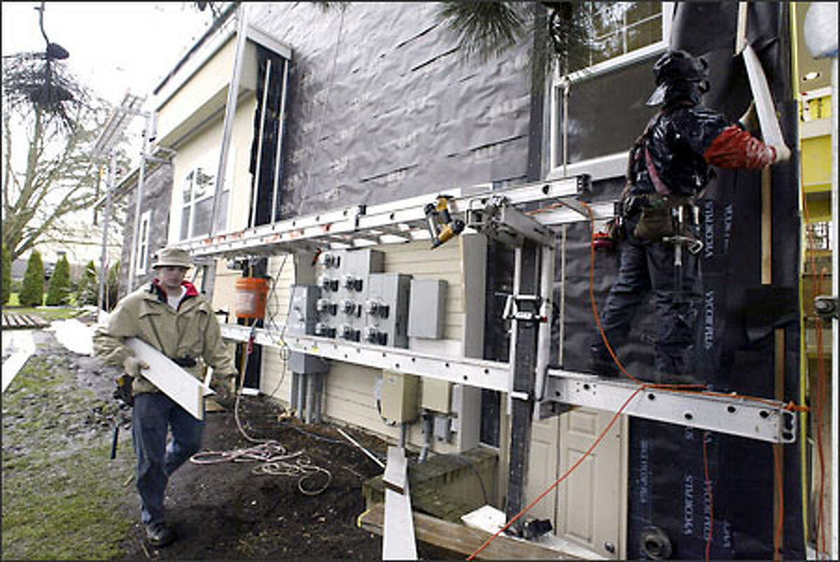 McGlynn Plastering has been repairing the Everest Estates condominiums in Kirkland because of poor workmanship in several areas of construction.