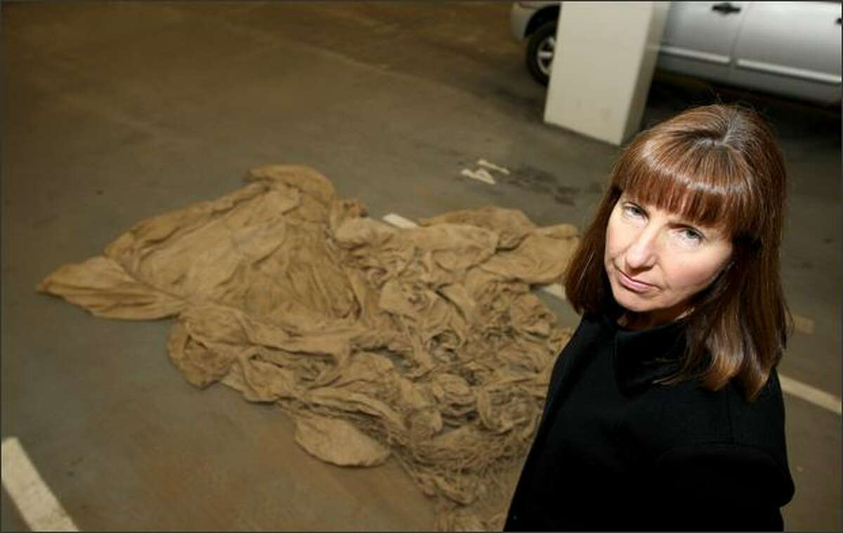 FBI special agent Robbie Burroughs poses with a parachute found in northern Clark County. She is working to find out if it is linked to the infamous D.B. Cooper case from 1971. (AP Photo/Kevin P. Casey)