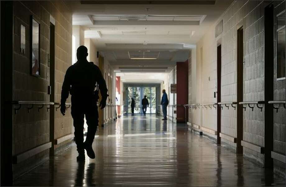 A security officer walks the hall at Western State Hospital in Lakewood, in a Seattle Post-Intelligencer file photo. Police say Biftu Dadi's killer drove to the state mental hospital with the young woman's body in the car. Photo: Dan DeLong, Seattle Post-Intelligencer / Seattle Post-Intelligencer