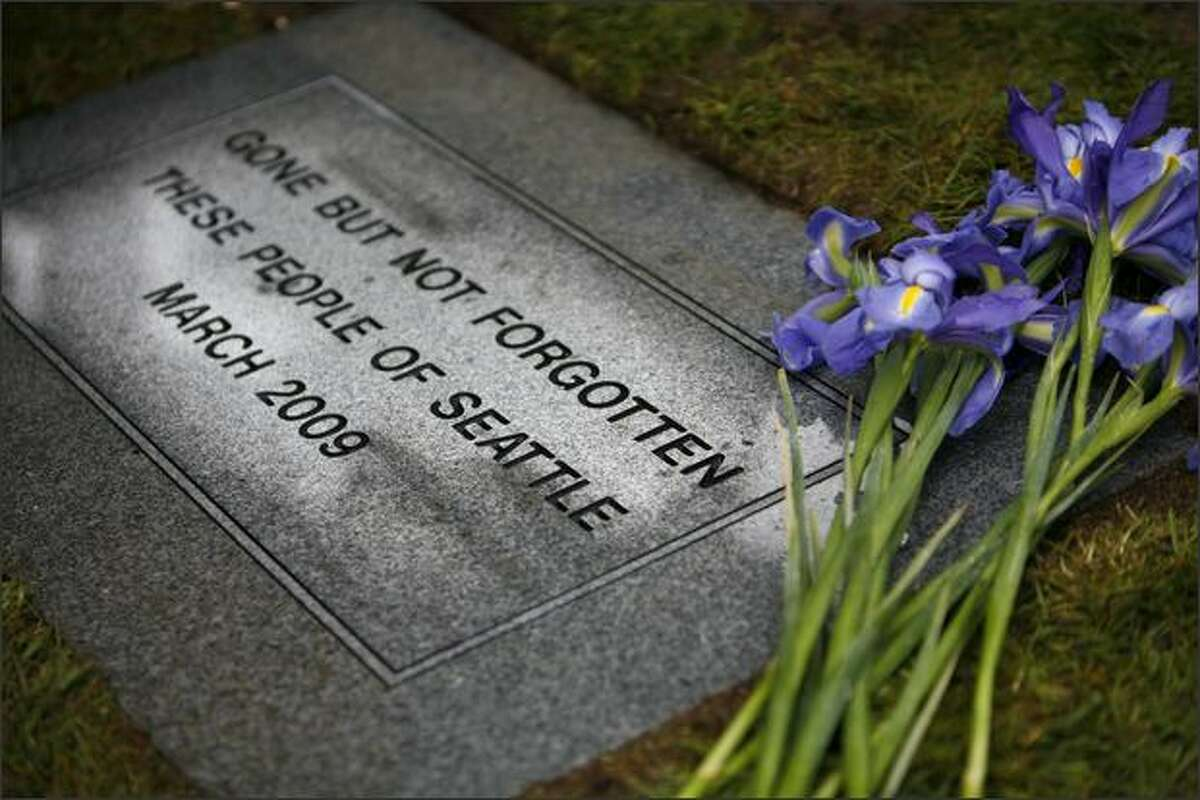 A marker shows where the remains of 209 deceased and unclaimed people were buried at Mount Olivet Cemetery in Renton.