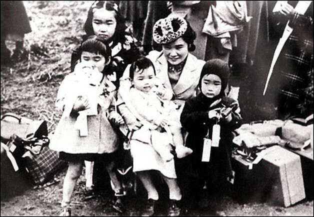 Two-year-old Frank Kitamoto, in jacket and hood, is pictured in 1942 with his mother, Shigeho Kitamoto, and his siblings before they were forced to leave Bainbridge Island for an internment camp. Photo courtesy of Frank Kitamoto.