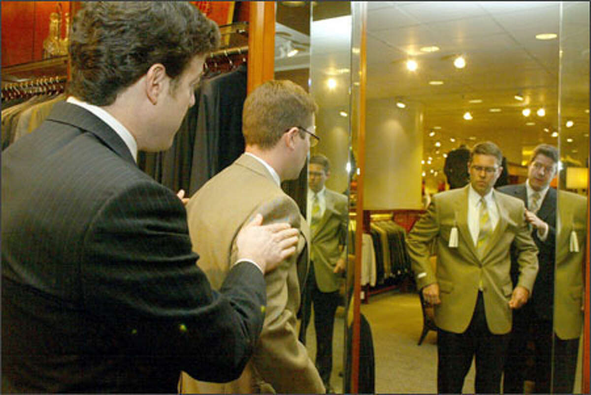 Brett Blake, left, and Clay Nielsen check out a sport coat at Nordstrom.