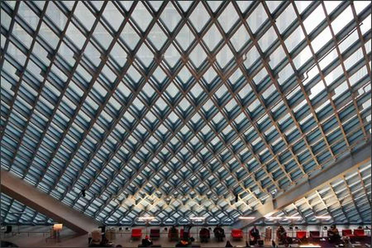 """The """"Living Room,"""" which has the feel of a vast indoor park, is not conducive to intimacy with a book. The huge overhead space, a thrill to library visitors, works against readers, who mostly crave private spaces for curling up with a book."""