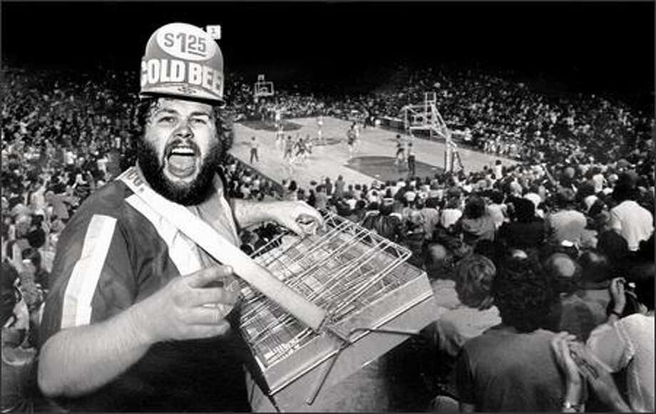 """Bill the Beerman"" got his start in 1976 selling beer at Mariners games at the Kingdome, later gravitating to Seahawks and Sonics. Photo: P-I File / P-I File"