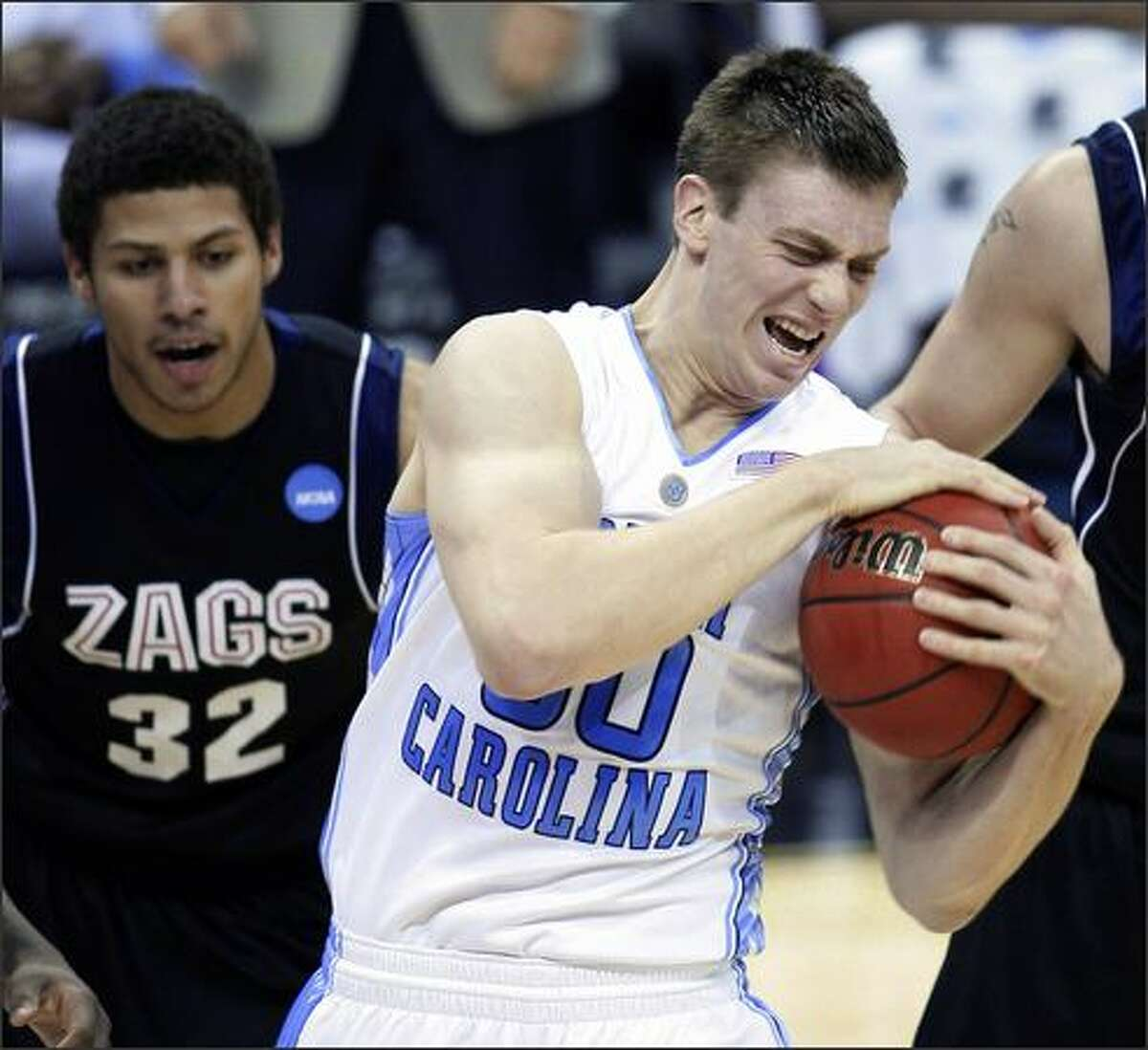 North Carolina forward Tyler Hansbrough (50) pulls a rebound away from Gonzaga guard Steven Gray (32) in the first half of an NCAA tournament regional semifinal game in Memphis, Tenn., Friday, March 27, 2009. (AP Photo/Matt Slocum)