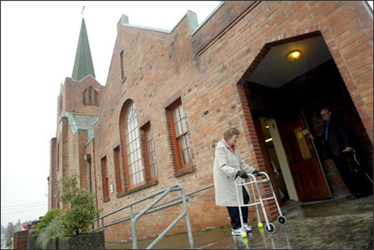 Violett Keane walks into St. James Lutheran Church in South Seattle on her way to Easter service yesterday. The church is closing its doors because attendance has fallen.