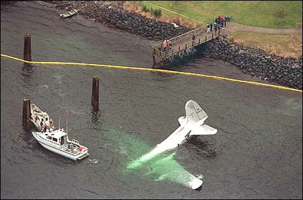 The last Boeing 307 Stratoliner in existence crash-landed into Elliott Bay today with four people on board. All escaped serious injury. Witnesses said the plane sputtered and appeared headed toward a popular West Seattle restaurant when it ditched into the bay.