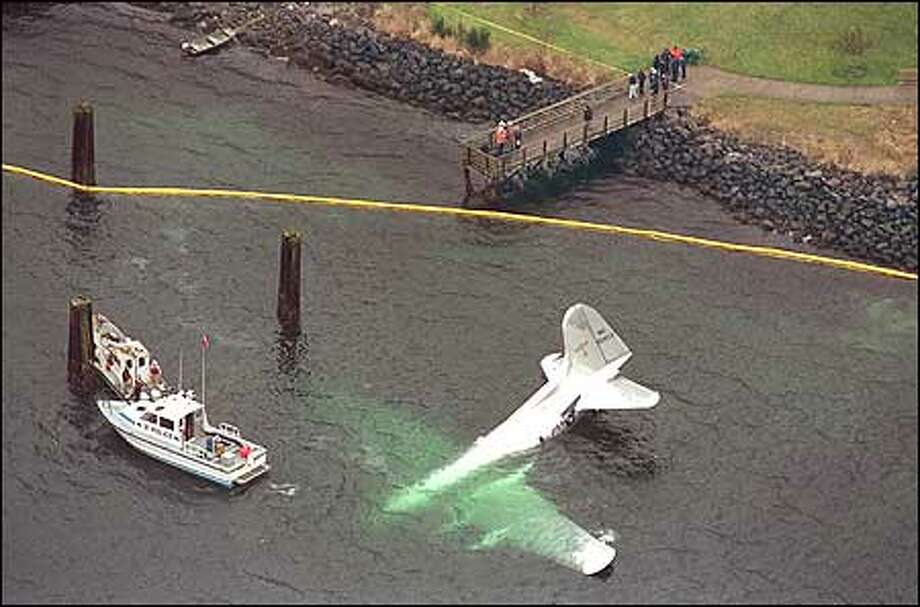 The last Boeing 307 Stratoliner in existence crash-landed into Elliott Bay today with four people on board. All escaped serious injury. Witnesses said the plane sputtered and appeared headed toward a popular West Seattle restaurant when it ditched into the bay. Photo: Joshua Trujillo, Seattlepi.com / seattlepi.com