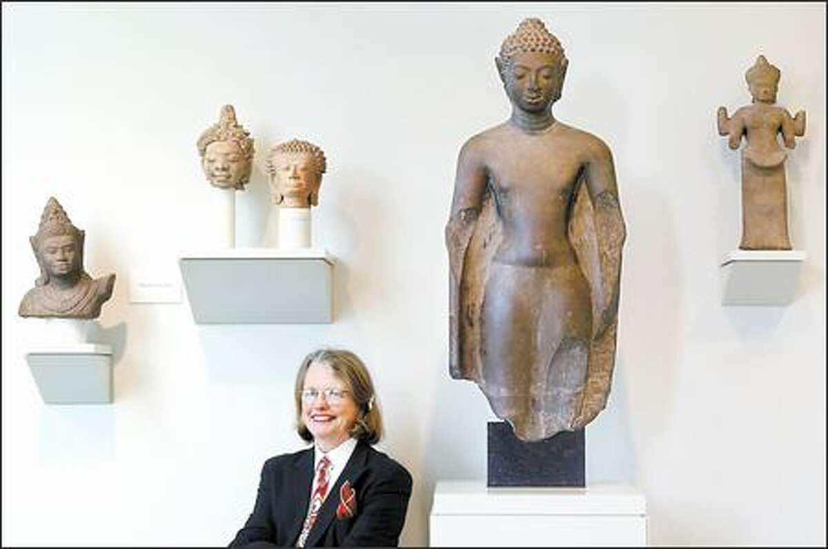 In her more than 10 years as director of the Seattle Art Museum, Mimi Gates, seen here at the Seattle Asian Art Museum, has persevered through change, massive growth and adversity.