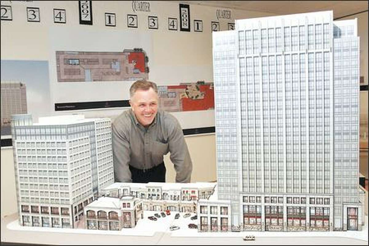 Dan Ivanoff, managing investment partner for Schnitzer Northwest, looks over a model of a development the company plans to build at 112th Avenue Northeast and Northeast Eighth Street in Bellevue. Ivanoff has taken the Civica office complex from development to sale.