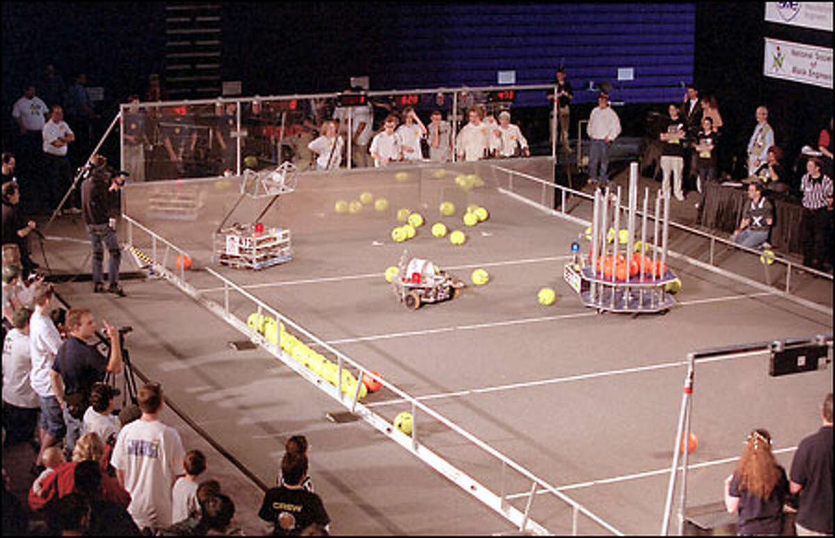 Robots in a soccerlike competition show their inventors' stuff yesterday at the University of Washington during the regional First competition, in which robot teams advance according to their accumulated points. For Inspiration and Recognition of Science and Technology, or First, began in the early 1990s under the leadership of Dean Kamen, the inventor of the talked-about Segway scooters.