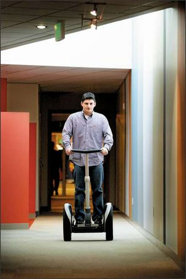 Keith Smith, CEO and Founder of 180solutions, rides a Segway down the hall at the company's headquarters in Bellevue. The company is a lot like dot-com companies of the '90s, with one exception: It is highly profitable. Photo: Joshua Trujillo, Seattlepi.com / seattlepi.com