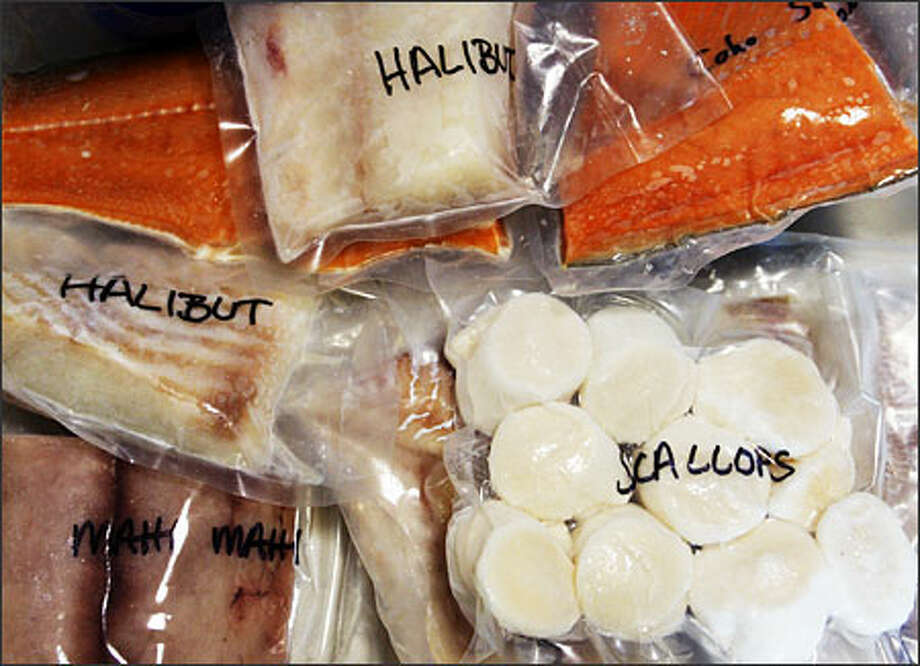 A sample of The Mini package that sells for $100. Each package usually contains five kinds of seasonal seafood. Photo: Gilbert W. Arias, Seattle Post-Intelligencer / Seattle Post-Intelligencer