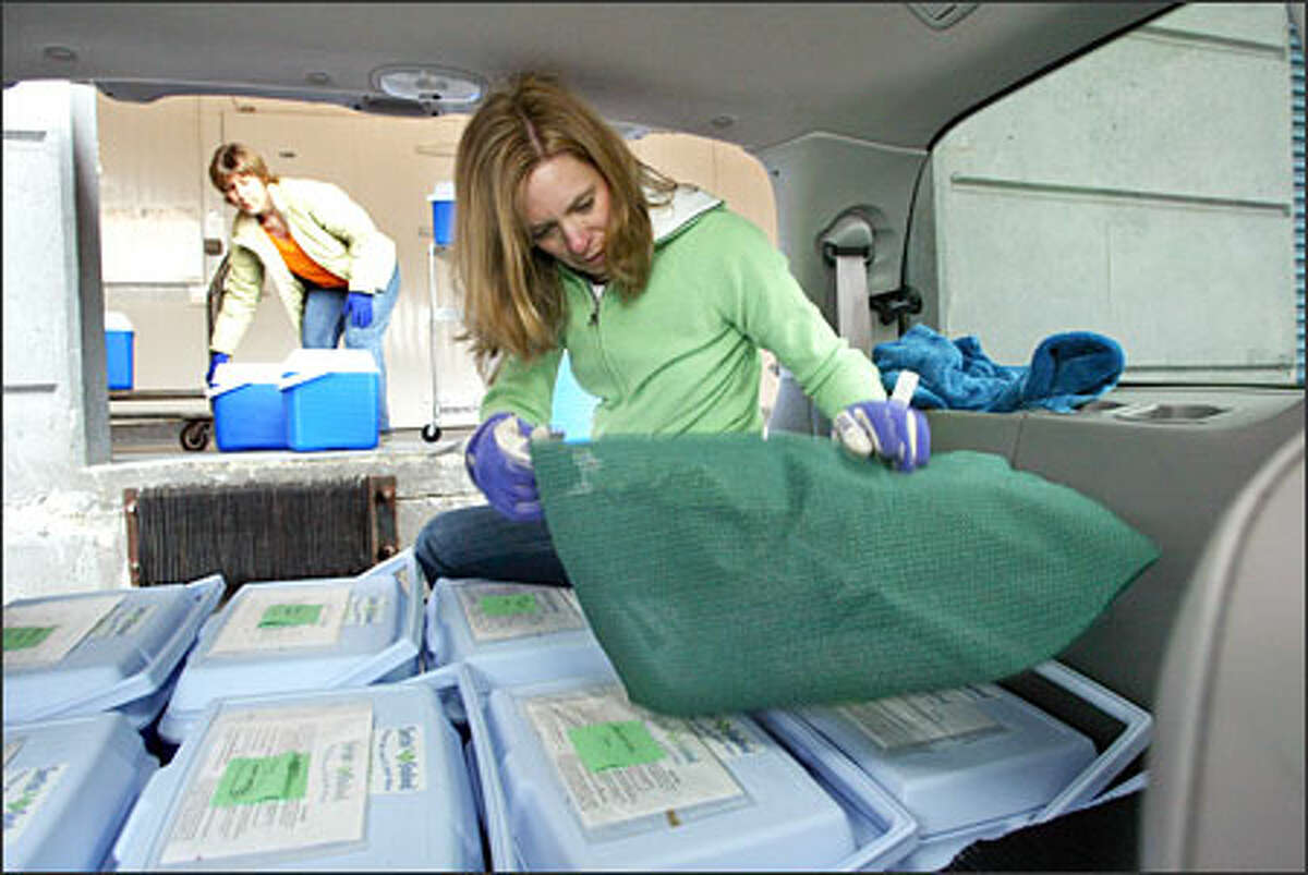 Surfin' Seafood owners Tina Montgomery, left, and Jennifer Hanseler get ready to make a monthly delivery of flash-frozen seafood to their customers' homes.