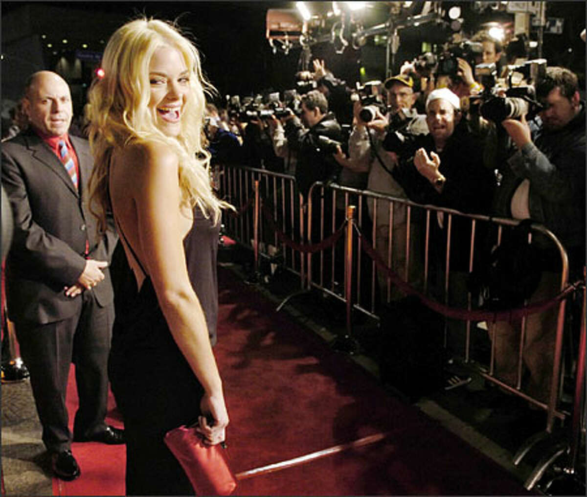 """The """"Sin City"""" premiere in Los Angeles was quite the red carpet scene. Cast member Jaime King was just one of the well-dressed females who gowned up, along with Brittany Murphy, Devon Aoki and Rosario Dawson. Bruce Willis, meanwhile, went for jeans. The film is set for release Friday."""