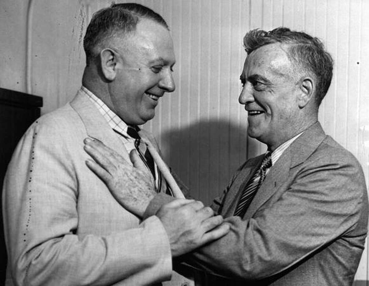 Notorious bandit Roy Gardner, right, pictured in June 1938 with Louis Sonney, the man who captured him as a Centralia police officer. Sonney became a film distributor and offered Gardner a job lecturing on why crime didn't pay. Gardner was released from prison that year. (seattlepi.com file)