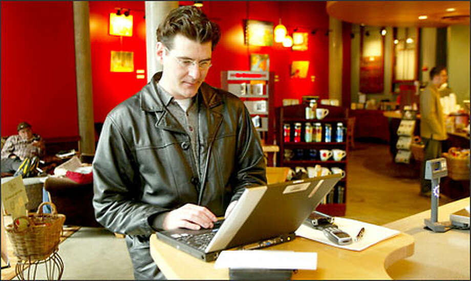 New wireless technology allows associate real-estate broker Edward Krigsman to go to the Belltown Starbucks without giving up his Internet access. Photo: Phil H. Webber, Seattle Post-Intelligencer / Seattle Post-Intelligencer