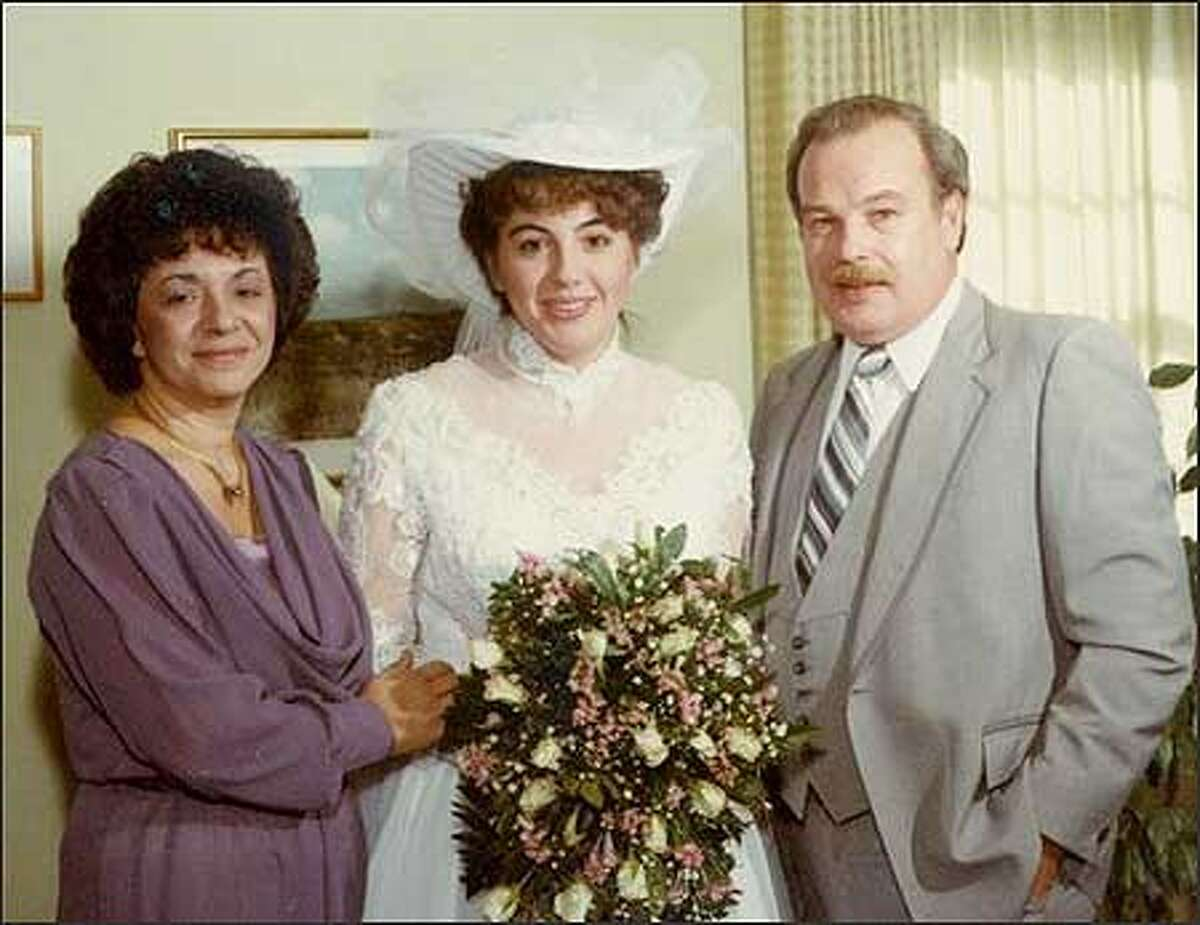 Terri Schiavo is shown in this undated photo from the Schindler family, posing with her father Bob and mother Mary. Schiavo suffered brain damage in 1990 when her heart stopped briefly from a chemical imbalance believed to have been brought on by an eating disorder. The severely brain-damaged woman's feeding tube was removed by court order Friday after 15 years. The case sparked an epic legal battle that went all the way to the White House and Congress. She died Thursday, 13 days after the tube was removed, her husband's attorney said. She was 41. (AP Photo/Schindler Family, File)