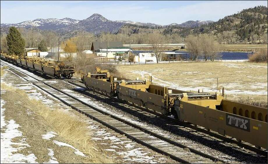 Rail cars have been parked beside the Missouri River between Great Falls and Helena, Mont., for about three months. Photo: Associated Press / Associated Press