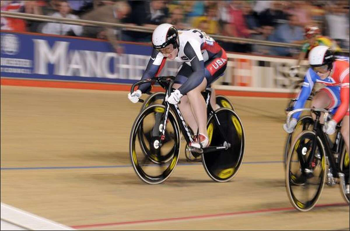 Jennie Reed surges ahead of Great Britain's Victoria Pendleton to win the keirin title at the track cycling world championships.