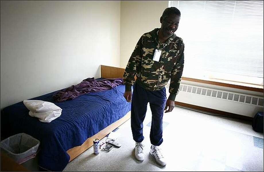 Nathaniel Porter, a resident at 1811 Eastlake - a home for people with chronic alcohol addiction - shows off his living quarters. Operated by the Downtown Emergency Service Center, the home offers residents a place to live safely while continuing to consume alcohol. A University of Washington study found the home saved taxpayers more than $4 million in 12 months because fewer residents visited emergency rooms, spent time in jail or relied on other social services. Photo: Joshua Trujillo, Seattlepi.com / seattlepi.com