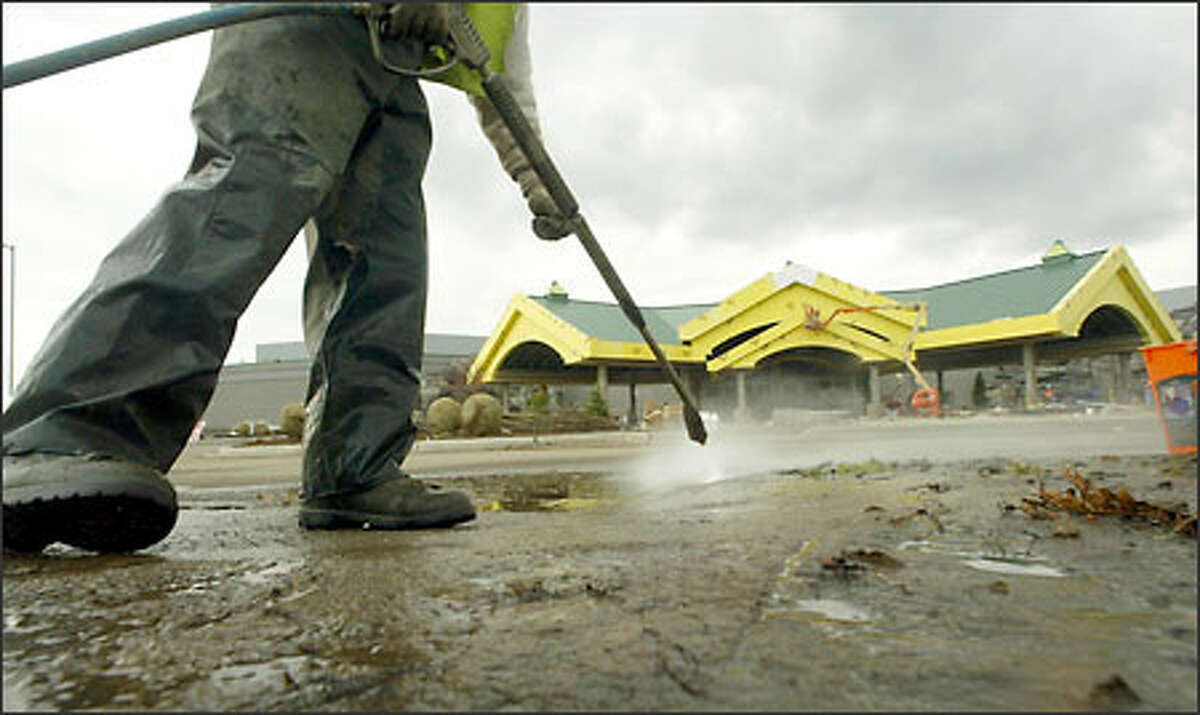 Shawn Warn cleans the walkway around the new Tulalip Casino. The casino is scheduled to open in May and is expected to create 400 to 500 jobs.