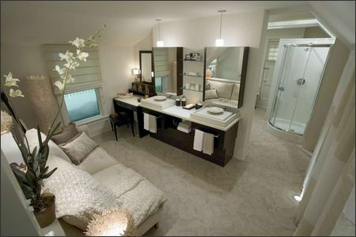 After: Modern finishes and fixtures, plus luxurious fabrics and accessories add up to a lush bathroom.
