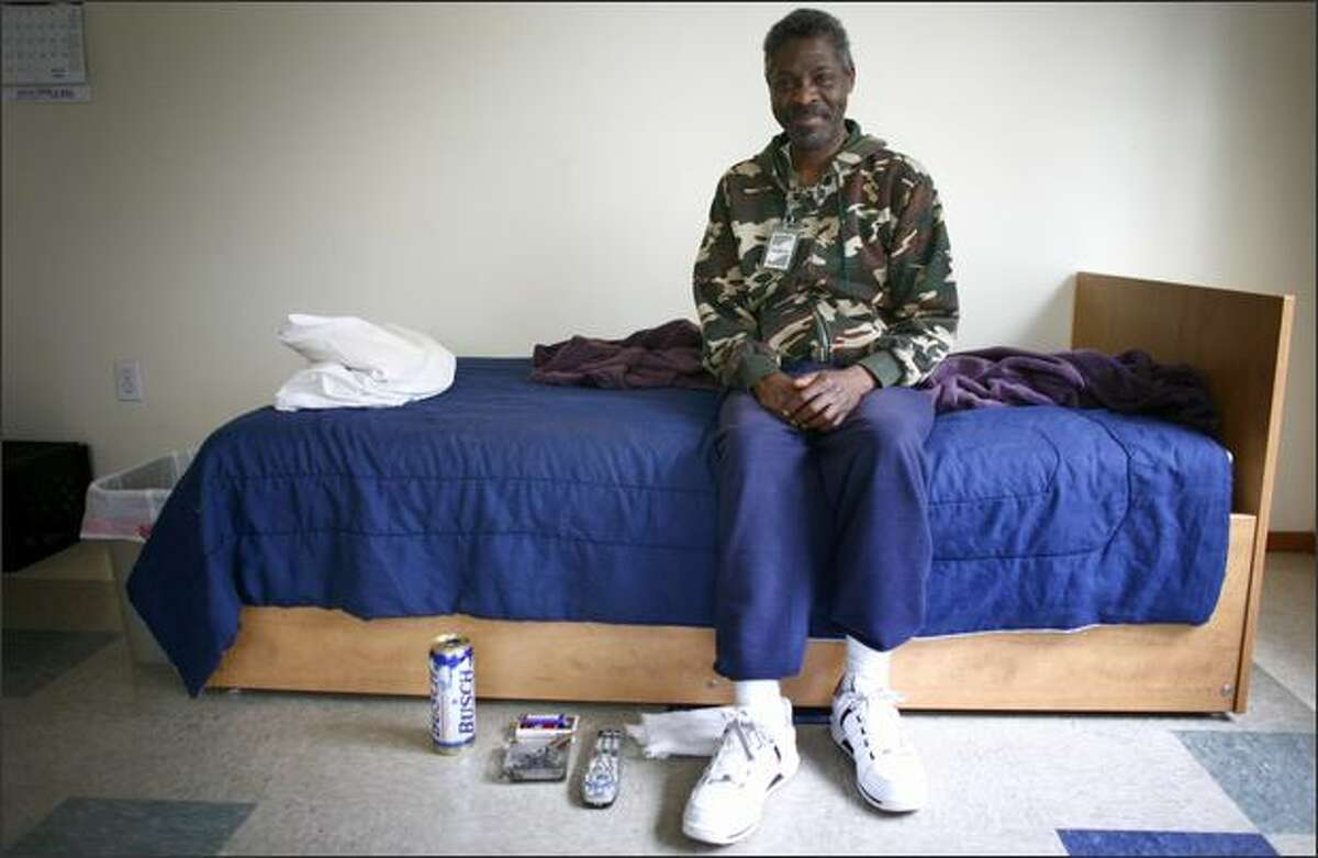 Nathaniel Porter, one of the residents at 1811 Eastlake Ave., a home for people with chronic alcohol addiction, shows off his living quarters Tuesday. The home offers alcoholics a place to live safely while continuing to consume alcohol.