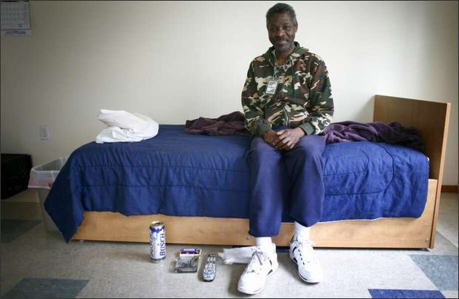 Nathaniel Porter, one of the residents at 1811 Eastlake Ave., a home for people with chronic alcohol addiction, shows off his living quarters Tuesday. The home offers alcoholics a place to live safely while continuing to consume alcohol. Photo: Joshua Trujillo, Seattlepi.com / seattlepi.com