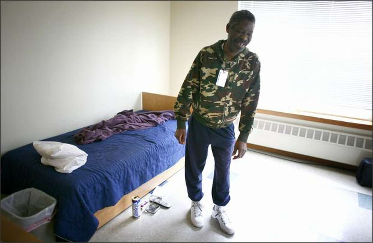 Nathaniel Porter, one of the residents of 1811 Eastlake, a home for people with chronic alcohol addiction, shows off his living quarters on Tuesday.