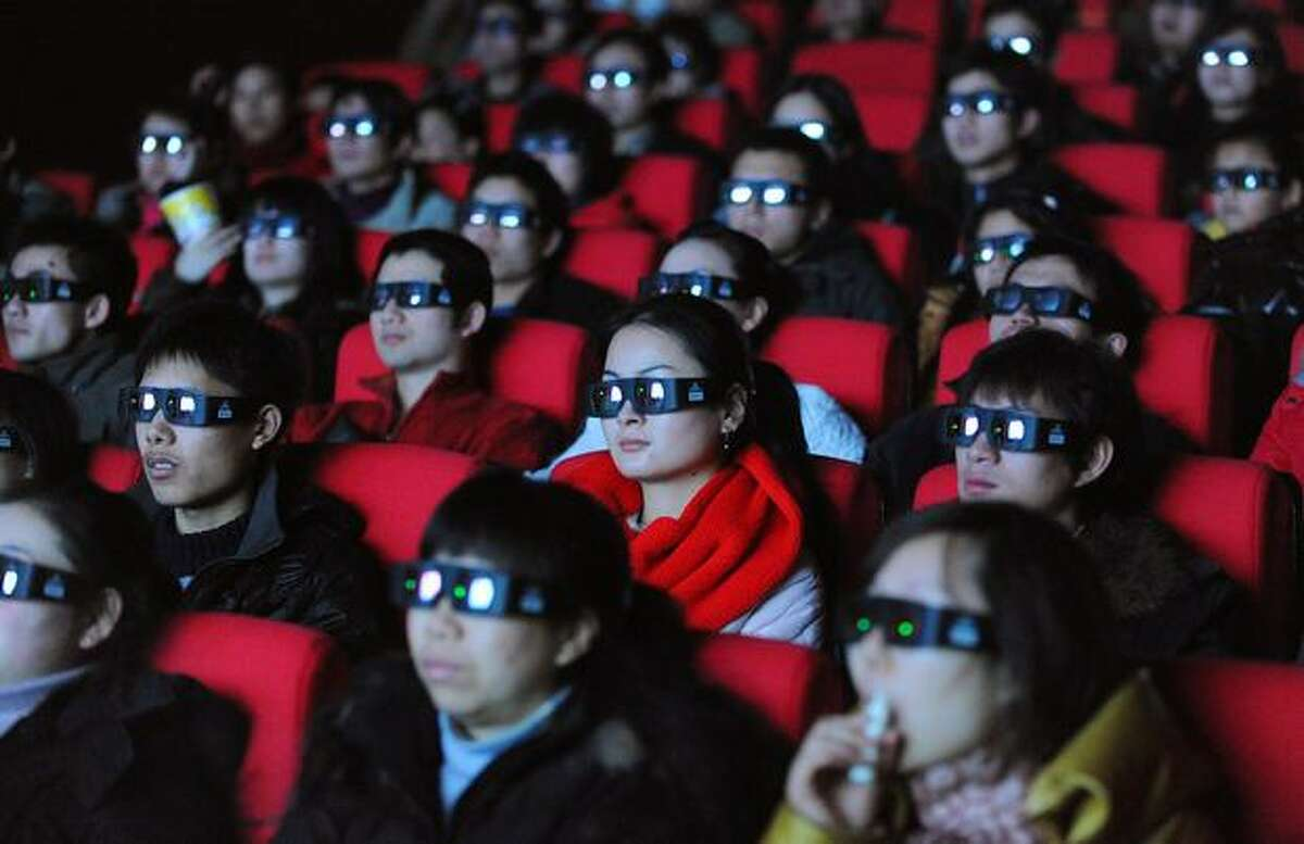 Movie-goers wear 3-D glasses as they watch the science-fiction blockbuster