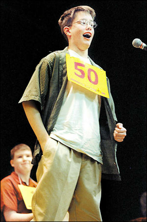 Washington Middle School eighth-grader Patrick Daughters wins the regional spelling bee championship for King and Snohomish counties at Seattle University yesterday over second-place Christopher Richards, in background. Photo: Melina Mara, Seattle Post-Intelligencer / Seattle Post-Intelligencer