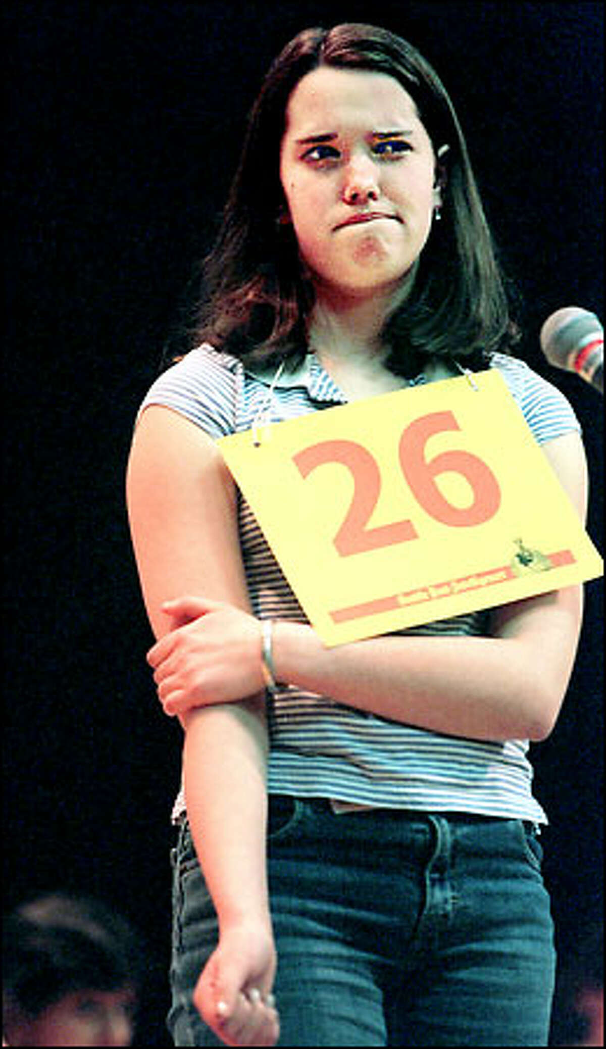 McMurray Middle School seventh grader Justine Eister is challenged by a word during the Regional Spelling Bee Championship Sunday at Seattle University.