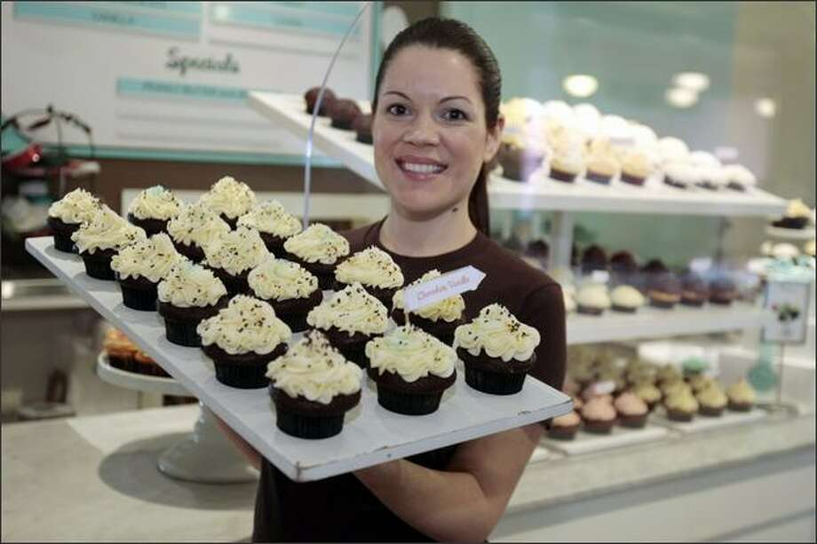 "Trophy Cupcakes owner Jennifer Shea is going on ""The Martha Stewart Show"" to explain how to make a S'mores cupcake and a roselike frosting. Photo: Meryl Schenker, Seattle Post-Intelligencer / Seattle Post-Intelligencer"