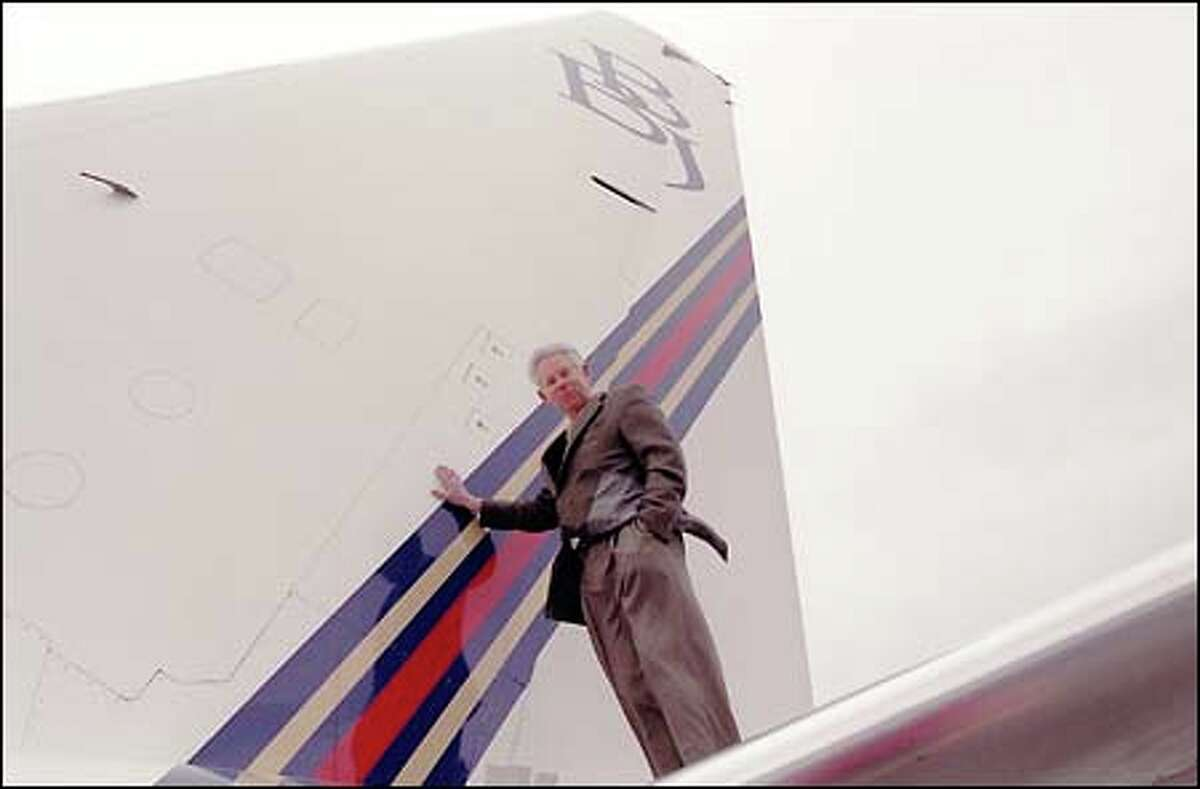 Borge Boeskov, retired president of Boeing Business Jets, stands on the tail of a BBJ. Boeskov plans to lecture at the University of Washington.