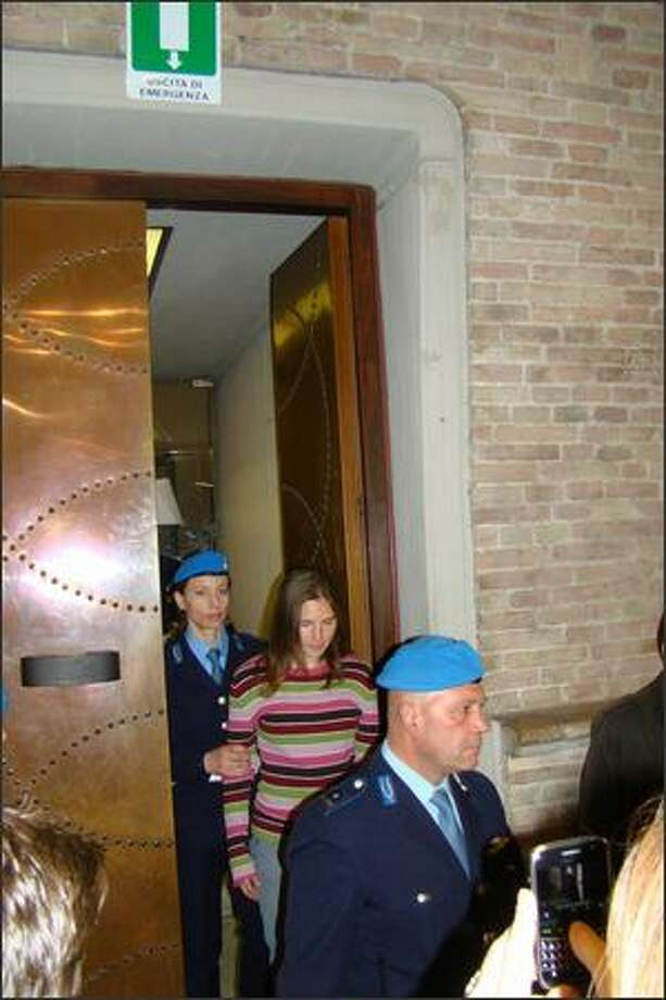 Amanda Knox enters the courtroom for Friday's hearing in Perugia, Italy. Photo: Andrea Vogt, Special To Seattlepi.com / Special to seattlepi.com