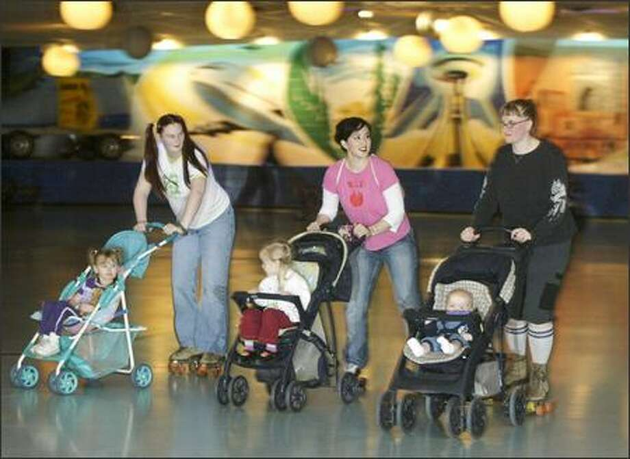 Seattle Punkymoms meet for a stroller skate in Bellevue: from left, Heather Bissonnette and daughter Jessica Henderson, 3; Thea Starr and daughter Nievis, 3; and Jessi Bloom-Kenney with 6-month-old Micah. Photo: Jim Bryant, Seattle Post-Intelligencer / Seattle Post-Intelligencer
