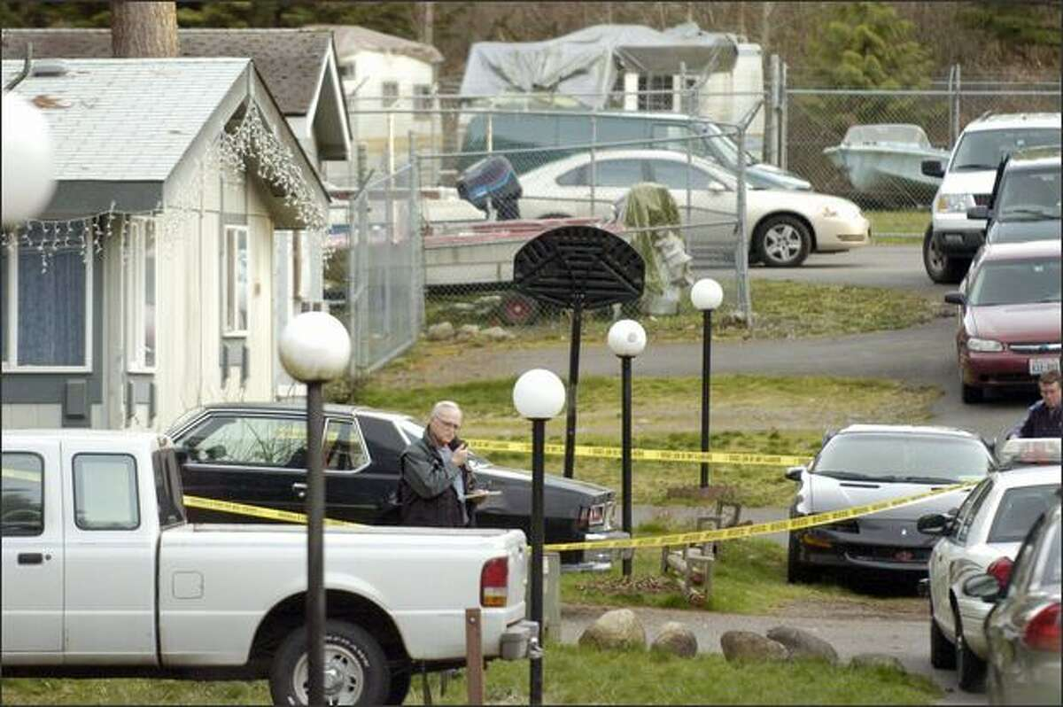 A home on the 20400 block of 135th Avenue Court East in Graham is cordoned off on Saturday as Pierce County Sheriff's officers investigate the apparent homicides of five children aged 7 to 16. Investigators believe the children may have been killed by their father, who was discovered dead early Saturday afternoon in King County. (AP Photo/The News Tribune, Joe Barrentine)