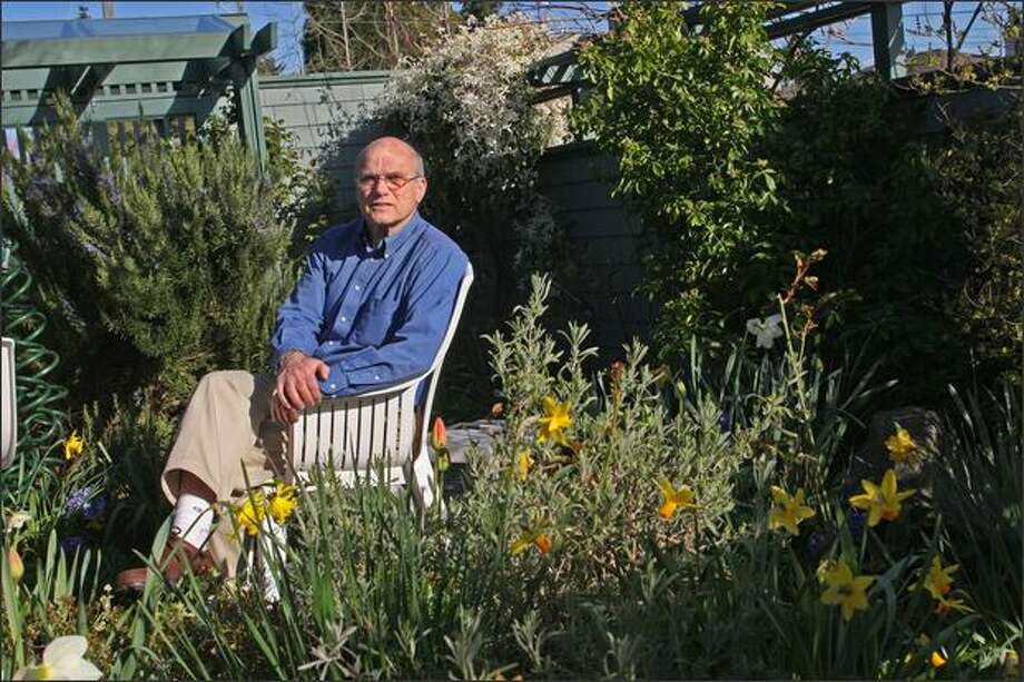 Holocaust survivor Peter Metzelaar sits in his yard in West Seattle. He and his mother hid from the Nazis for more than two years. They first were hidden at an elderly couple's farm in Holland, then fled to apartments in The Hague and Amsterdam. Photo: Mike Kane, Seattle Post-Intelligencer / Seattle Post-Intelligencer