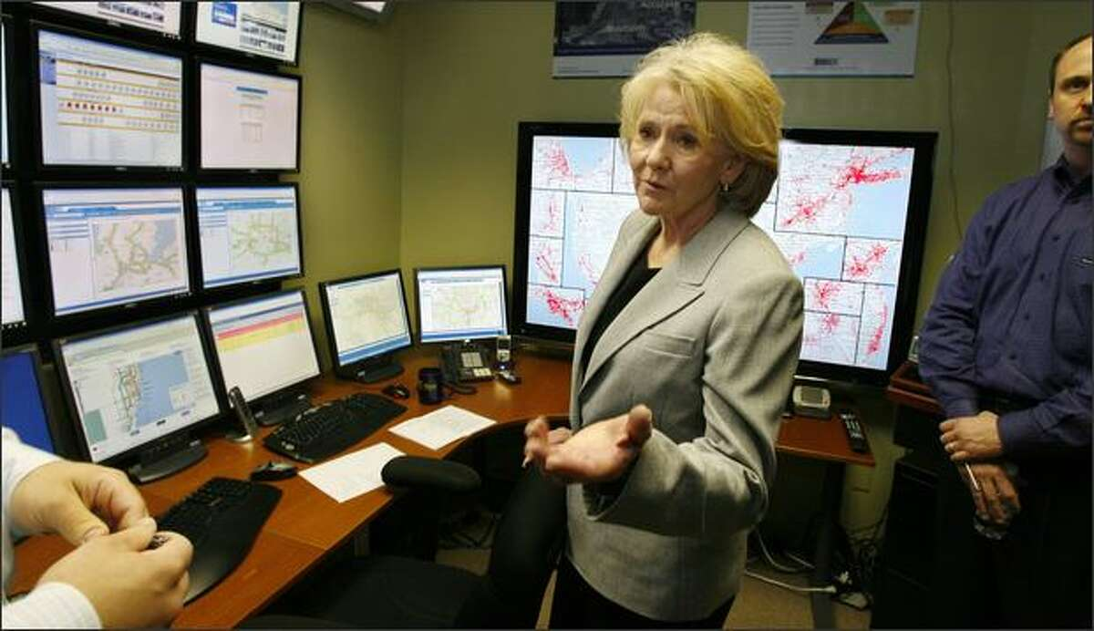 U.S. Transportation Secretary Mary Peters tours INRIX Inc., a Kirkland traffic-data firm, on Friday. Peters called the