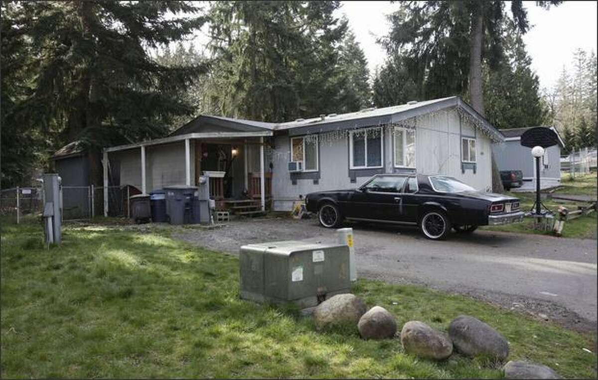 The home where the bodies of five children were discovered on Saturday is shown Sunday, April 5, 2009, at a trailer park near near Graham, Wash. Pierce County Sheriff's officials said they believe the children's father killed the children before committing suicide. (AP Photo/Ted S. Warren)